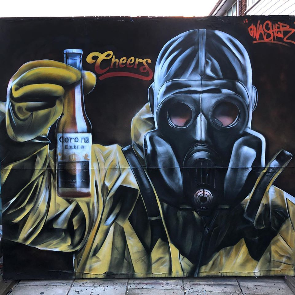 Coronavirus street art by Gnasher. Photo courtesy of the artist on Facebook.