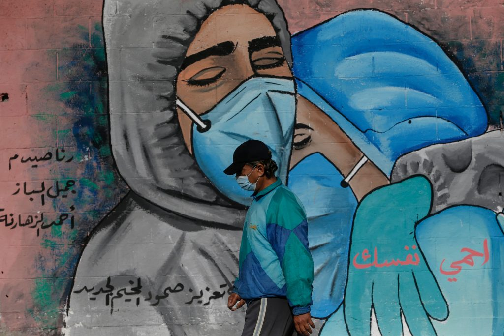 An urban artist painted a mural under a bridge to honor health workers who have given their lives to curb COVID-19 in Mexico City. Photo by Leonardo Casas/Eyepix Group/Barcroft Studios/Future Publishing via Getty Images.