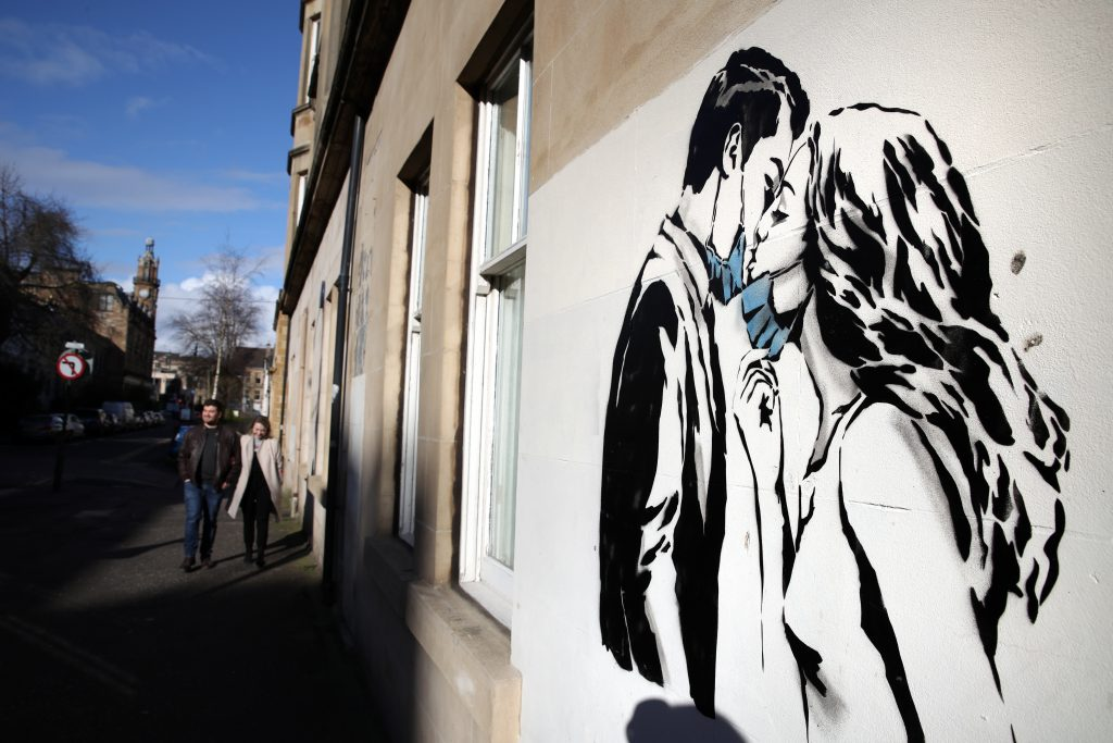 Street art by Rebel Bear on a wall on Bank Street in Glasgow. Photo by Andrew Milligan/PA Images via Getty Images.