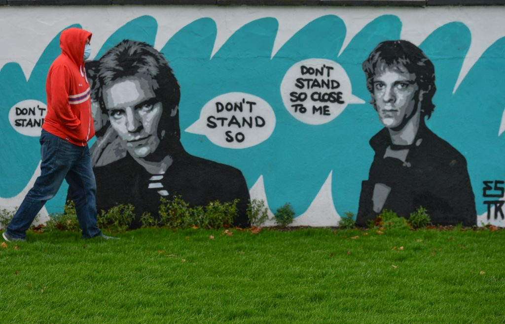"A mural of the Police, by the Irish artist Emmalene Blake, located in South Dublin. This is the latest work in her ""Stay at Home"" series encouraging people to stick to social distancing. Photo by Artur Widak/NurPhoto via Getty Images."