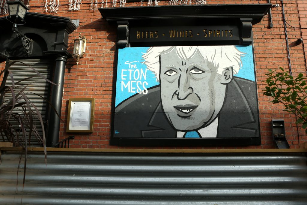 "Street art depicting Boris Johnson which reads ""The Eton Mess"" is seen at the Bay Horse Tavern in Manchester's Northern Quarter on November 09, 2020. Photo by Charlotte Tattersall/Getty Images."