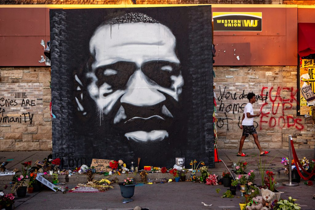 A large black and white mural of George Floyd's face stands tall on the sidewalk outside of Cup Foods near where Floyd was killed on Sunday, July 26, 2020 in Minneapolis. Photo by Jason Armond/Los Angeles Times via Getty Images.