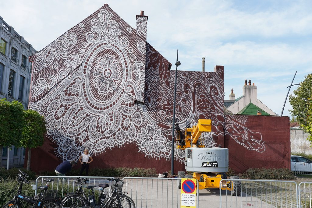 Polish street artist NeSpoon's lace mural on a wall of La Cite de la Dentelle et de La Mode on September 20, 2020 in Calais, France. Photo by Sylvain Lefevre/Getty Images.