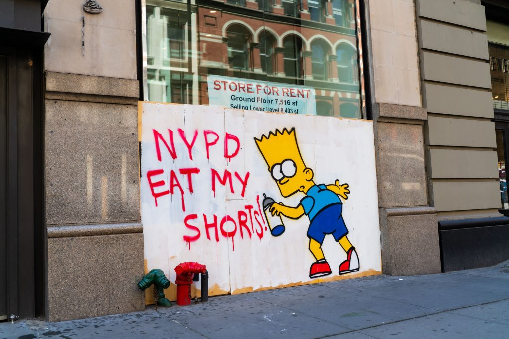 Street art featuring the character Bart Simpson is on display on a boarded-up building in SoHo on June 21, 2020 in New York City. Photo by Gotham/Getty Images.