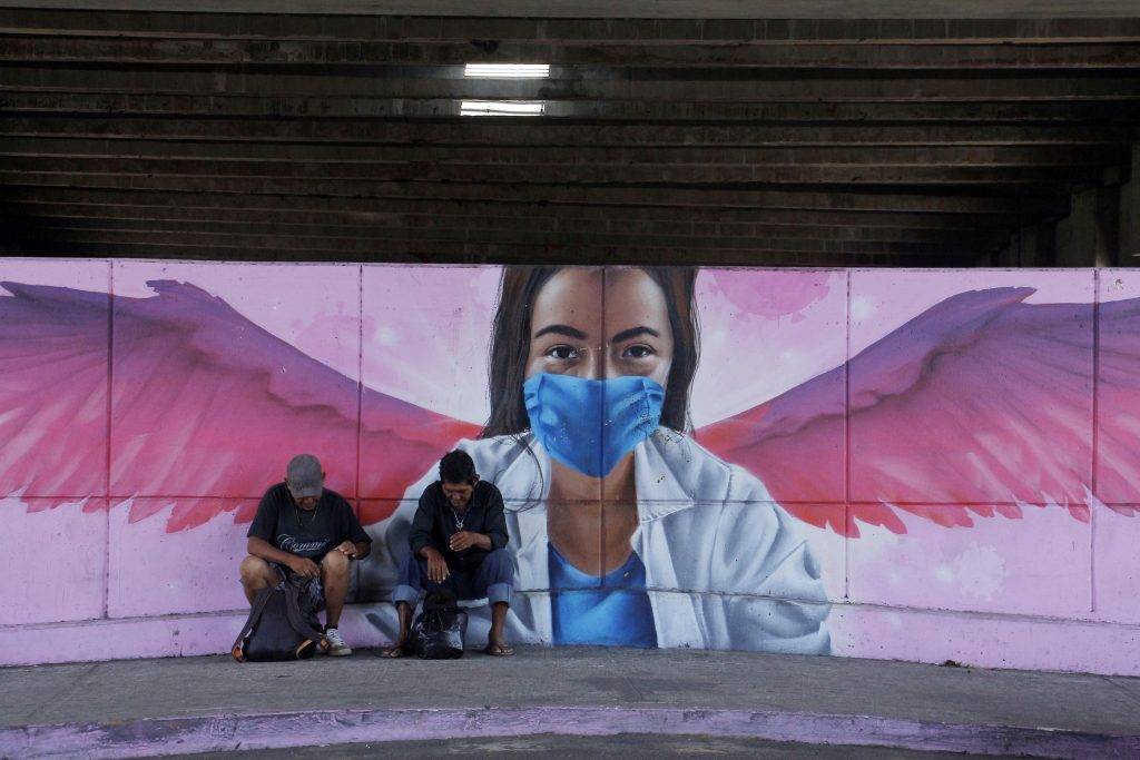 Street art of a medical worker with wings wearing protective mask to illustrate the Coronavirus (COVID-19 ) pandemic in Mexico City. Photo by Ricardo Castelan Cruz/Eyepix Group/Barcroft Studios/Future Publishing via Getty Images.