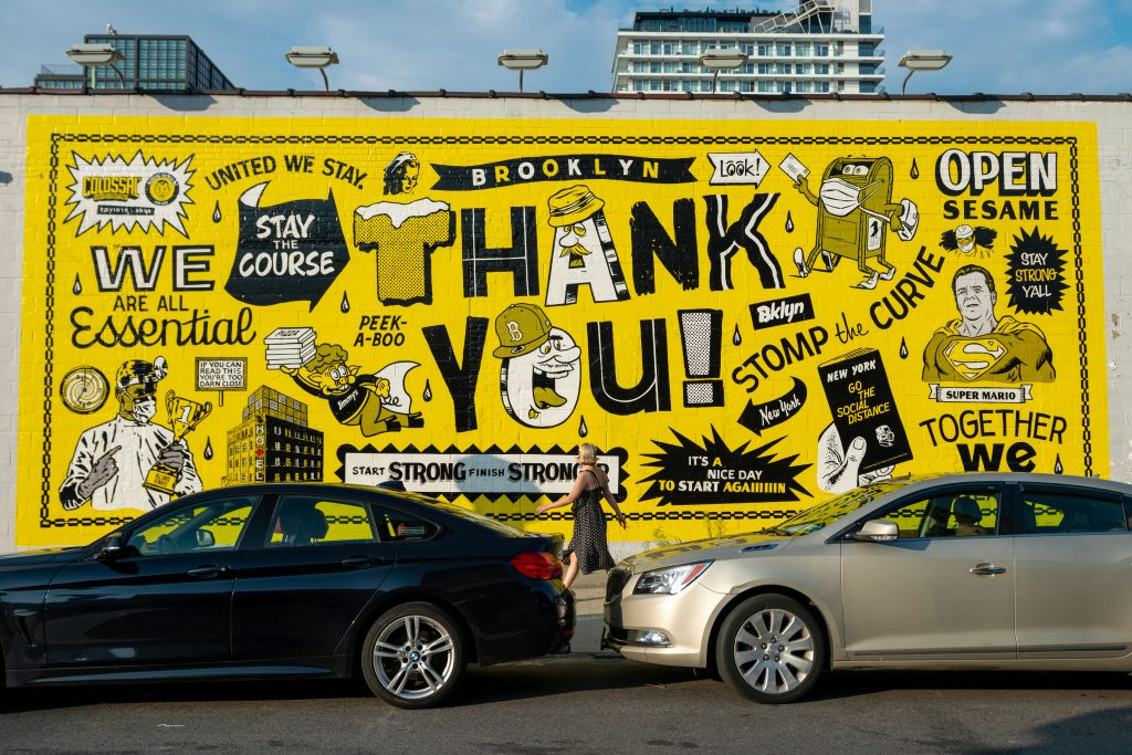 "A person walks past a large ""Thank you"" mural in Williamsburg, Brooklyn, on August 17, 2020. Photo by Alexi Rosenfeld/Getty Images."