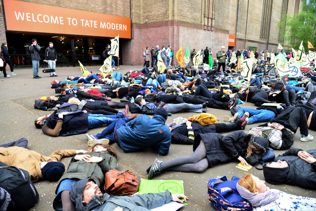 Activists from Extinction Rebellion stage a die in demonstration at Tate Modern. Photo by Claire Doherty/In Pictures via Getty Images Images.