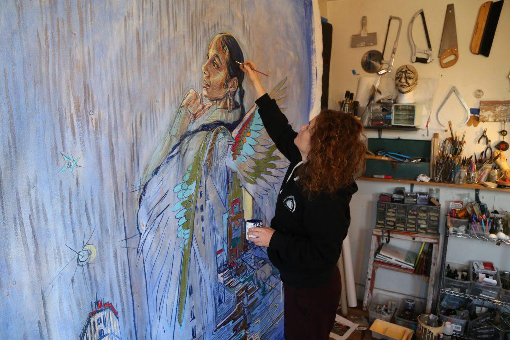 Swoon working on her portrait of Alicia Keys. Photo by Zahra Sherzad.