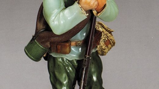 "This soldier figurine, which is being shown at the Hermitage as genuine Fabergé, has been dismissed by the director of the Fersman Mineralogical Museum in Moscow as a ""low-quality modern replica"" of Fabergé's Soldier of the Reserve (1915) in his museum."