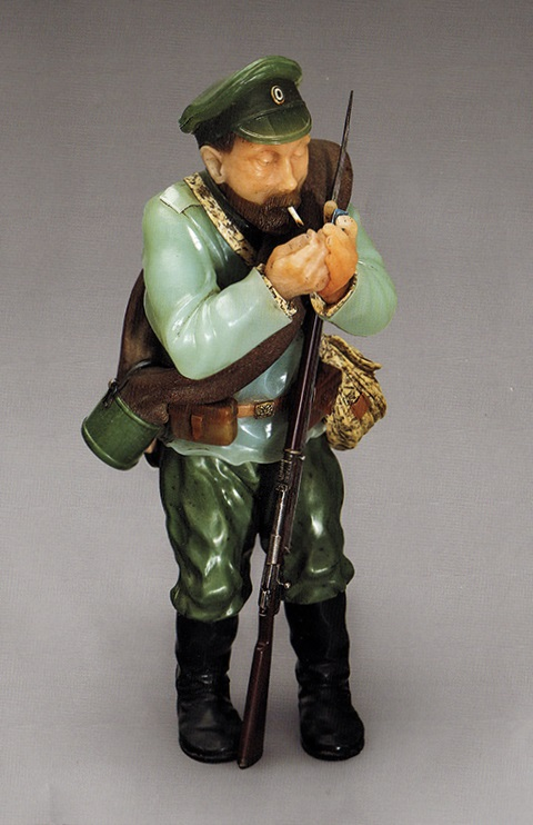 """This soldier figurine, which is being shown at the Hermitage as genuine Fabergé, has been dismissed by the director of the Fersman Mineralogical Museum in Moscow as a """"low-quality modern replica"""" of Fabergé's Soldier of the Reserve (1915) in his museum."""