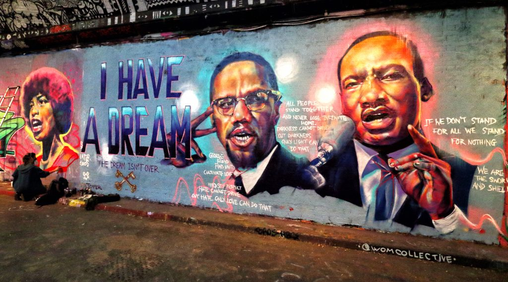 Street art of Martin Luther King and Malcolm X made in reference to the George Floyd killing at the famous Leake Street Tunnel under Waterloo station. Photo by Keith Mayhew/SOPA Images/LightRocket via Getty Images.