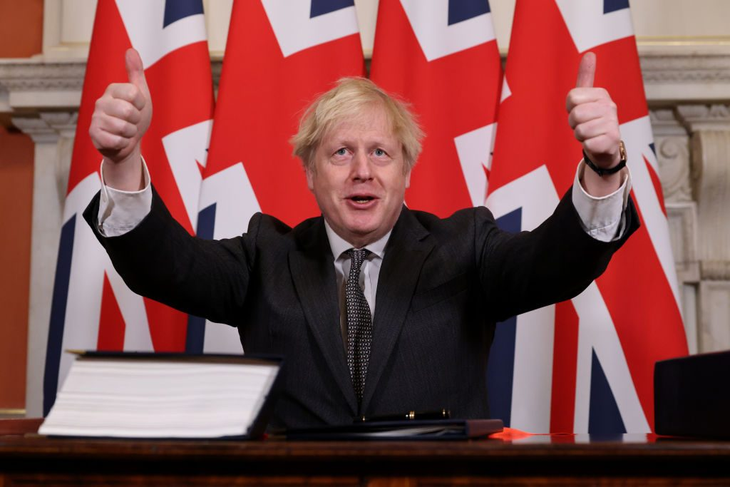 UK Prime Minister Boris Johnson gestures after signing the Brexit Trade Deal with the EU in 10 Downing Street in London, United Kingdom on December 30, 2020. Photo: Pippa Fowles/No10 Downing Street/Handout/Anadolu Agency via Getty Images.