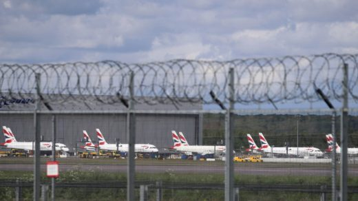 British Airways planes parked at Gatwick Airport as the UK continues in lockdown to help curb the spread of the coronavirus. Photo by Gareth Fuller/PA Images via Getty Images.