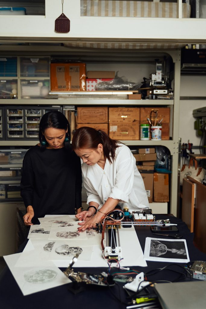 Ying Kwok and Phoebe Hui in the artist's Hong Kong studio. Images courtesy of the artist and Audemars Piguet.