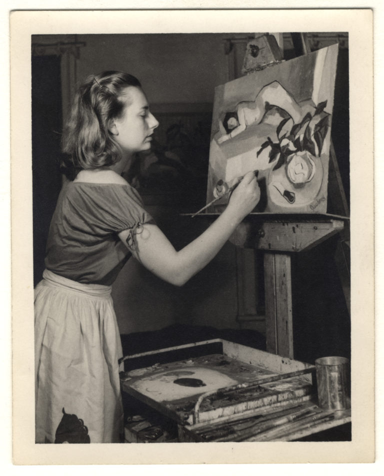 A young Grace Hartigan painting in her studio in the 1940s at the beginning of her artistic career. Image courtesy Syracuse University.
