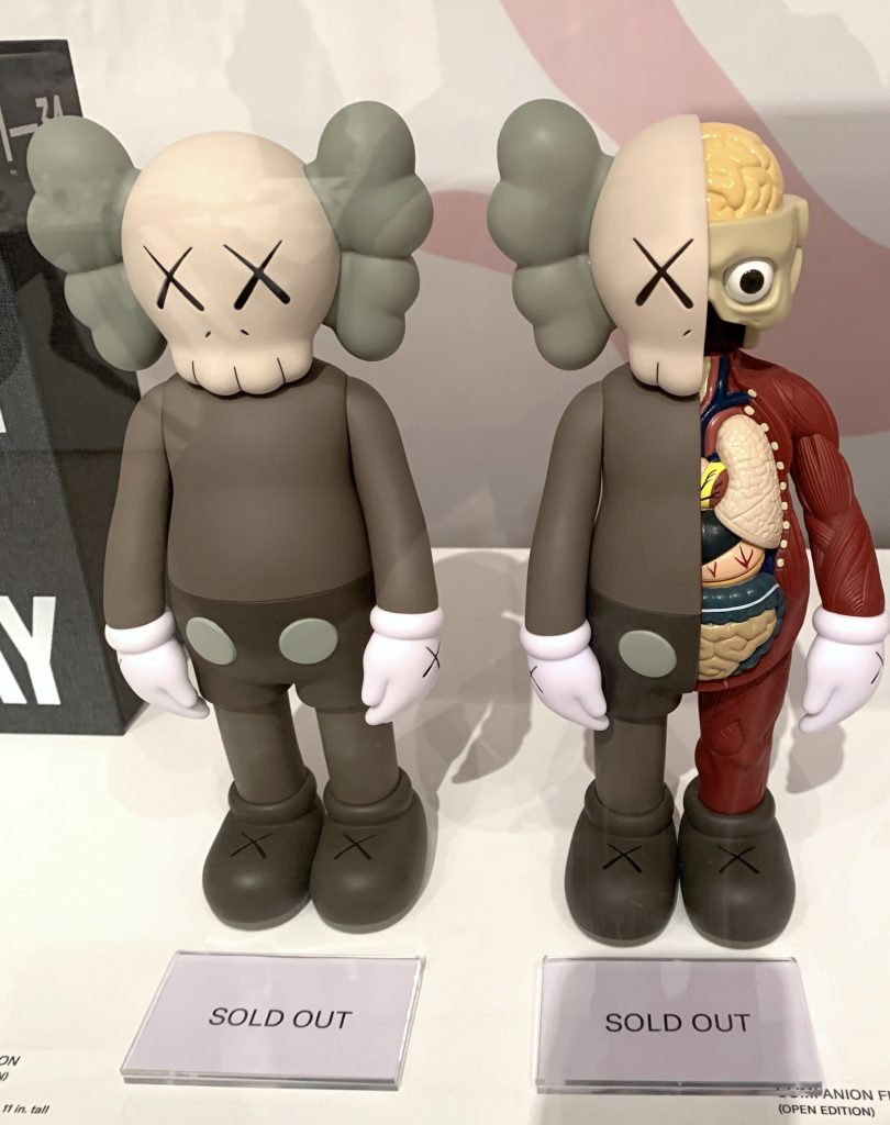 """Figurines for sale in the gift shop for """"KAWS: What Party"""" at Brooklyn Museum, already sold out. (Photo by Ben Davis)"""