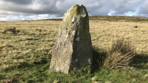 This standing stone at Waun Mawn in Wales is now believed to be among the remnants of an ancient stone circle that was deconstructed and used in the building of Stonehenge. Photo by Paul R. Davis, courtesy of the Royal Commission on the Ancient and Historical Monuments of Wales.