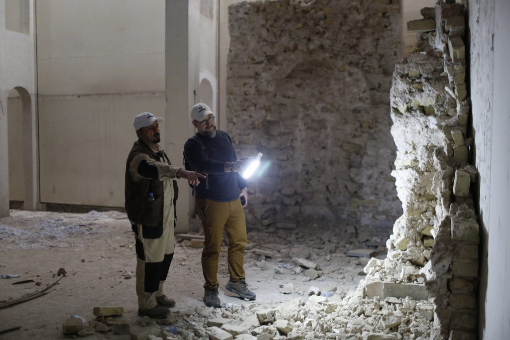 Mosul Cultural Museum Director Zaid Ghazi Saadullah (left) and Brian Michael Lione, the Smithsonian's Iraq program manager, survey a destroyed mihrab display in the Mosul Cultural Museum's Islamic Hall in February 2019. Photo courtesy of the Smithsonian Institution.