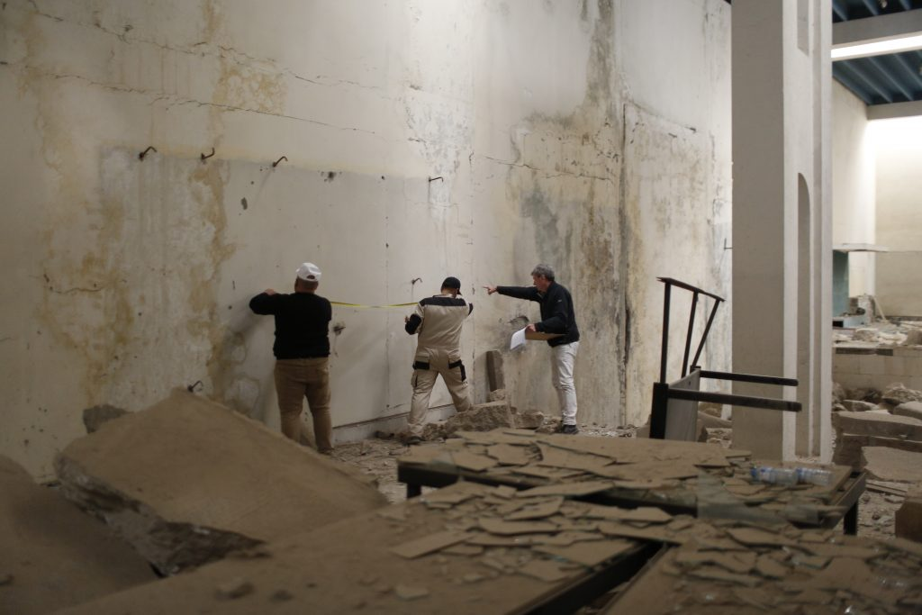 A joint Iraqi-Smithsonian team works to document the damage in the Mosul Cultural Museum's Assyrian Hall in February 2019. Photo courtesy of the Smithsonian Institution.