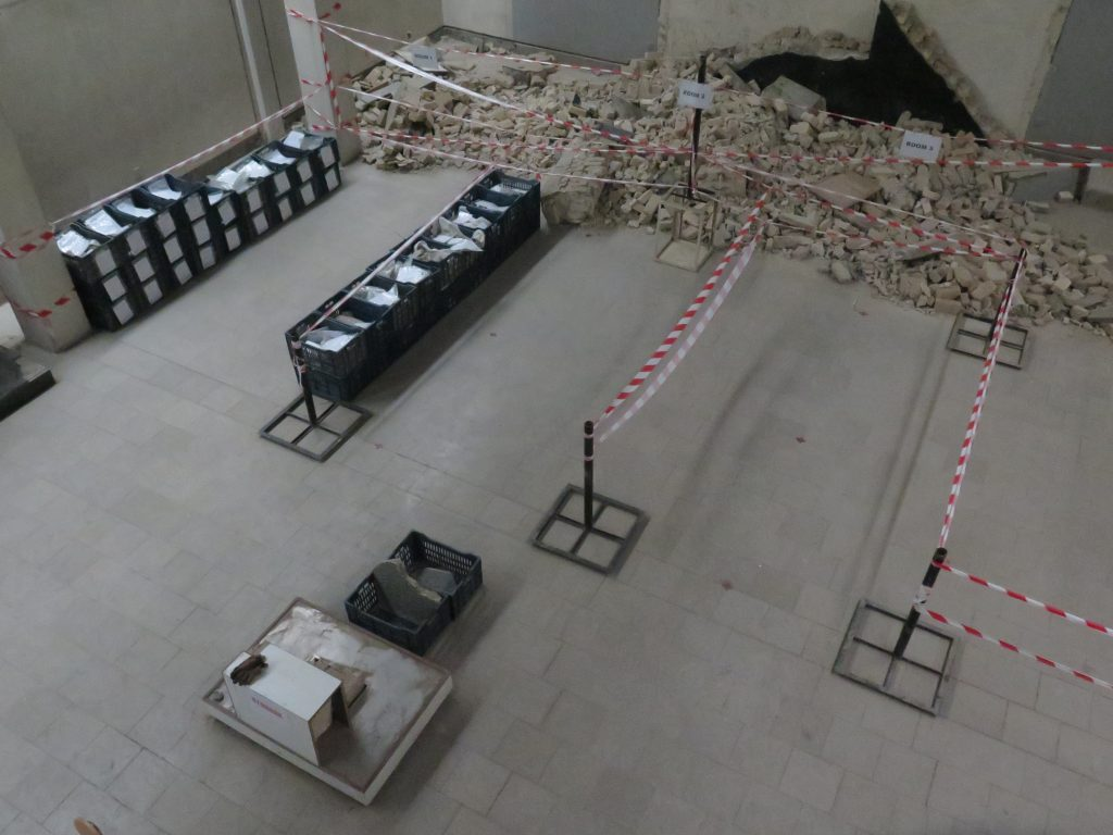 Fragments collected by Mosul Cultural Museum staff are carefully documented and placed into temporary storage as part of the recovery effort in August 2019. Photo courtesy of the Smithsonian Institution.