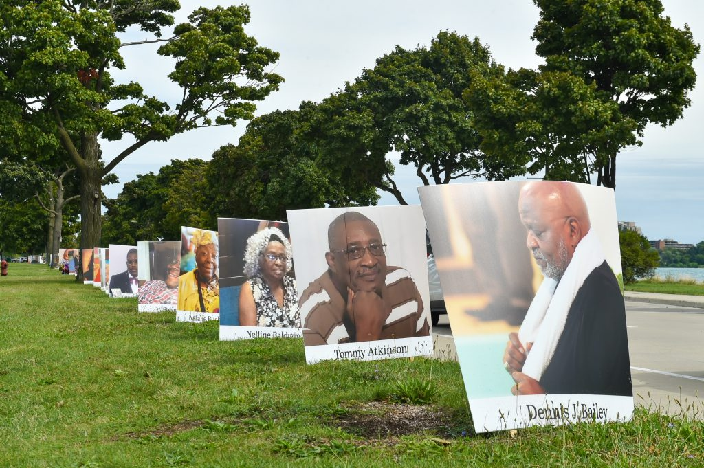 Images of COVID-19 victims from Detroit are displayed in a drive-by memorial at Belle Isle State Park on September 2, 2020 in Detroit, Michigan. Photo by Aaron J. Thornton/Getty Images.