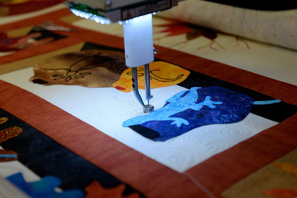 A quilter at work. Photo by Seth McConnell/The Denver Post via Getty Images.