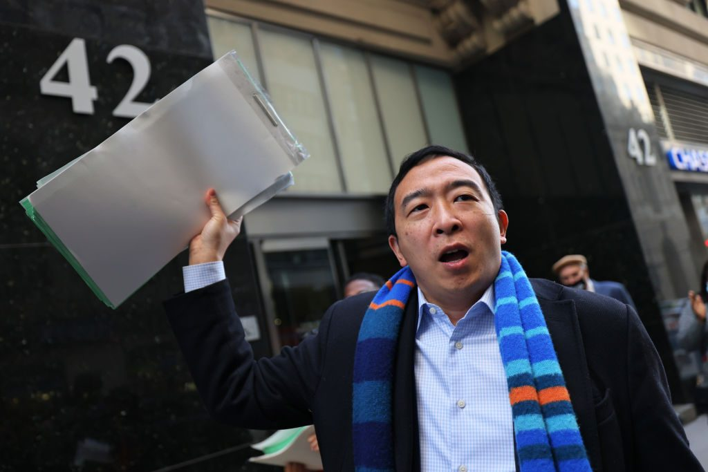 New York City mayoral candidate Andrew Yang holds up his campaign's petition signatures as he speaks outside the NYC Board of Elections office on March 23, 2021 in New York City. Photo by Michael M. Santiago/Getty Images.