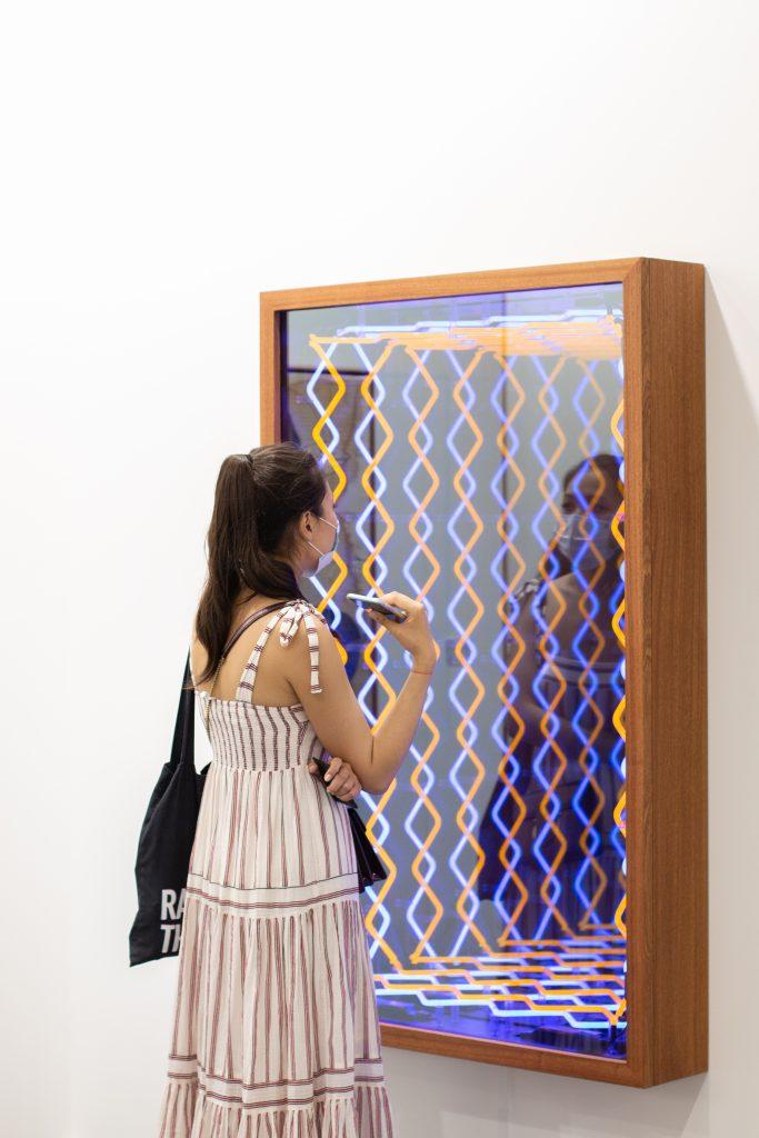 A visitor at Templon's booth at Art Dubai 2021. Courtesy of Art Dubai.