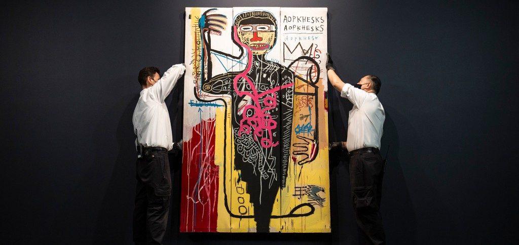 Art handlers with Basquiat's Versus Medici (1982). Courtesy of Sotheby's.