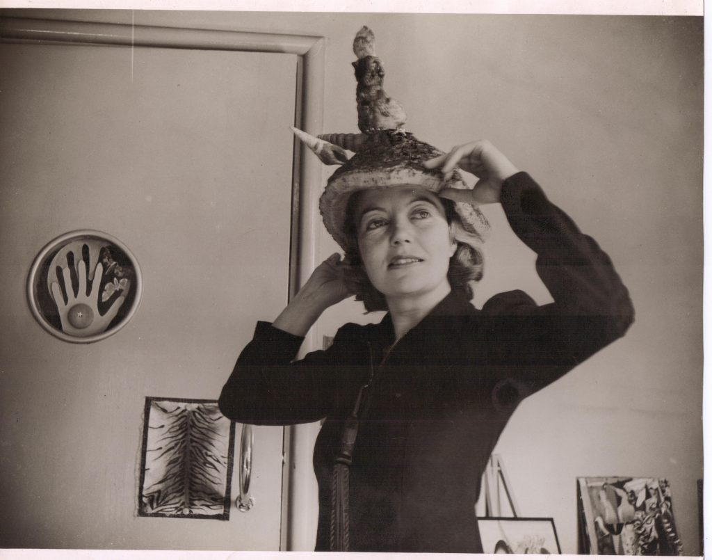 "Eileen Agar wearing a ""Ceremonial Hat for Eating Bouillabaisse."" The picture was taken in 1936. © The estate of Eileen Agar."