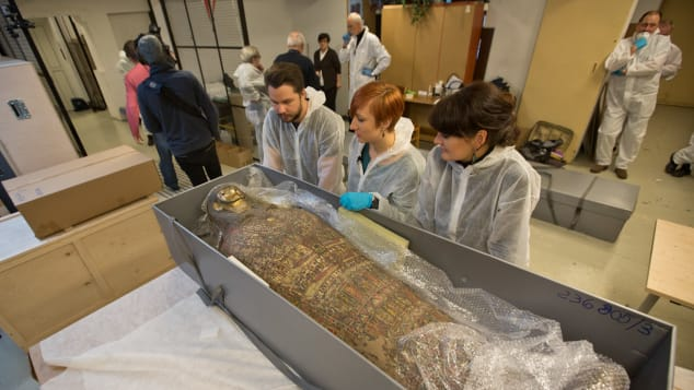 Experts at the Warsaw Mummy Project examining the world's first pregnant mummy. Photo courtesy of the Warsaw Mummy Project.