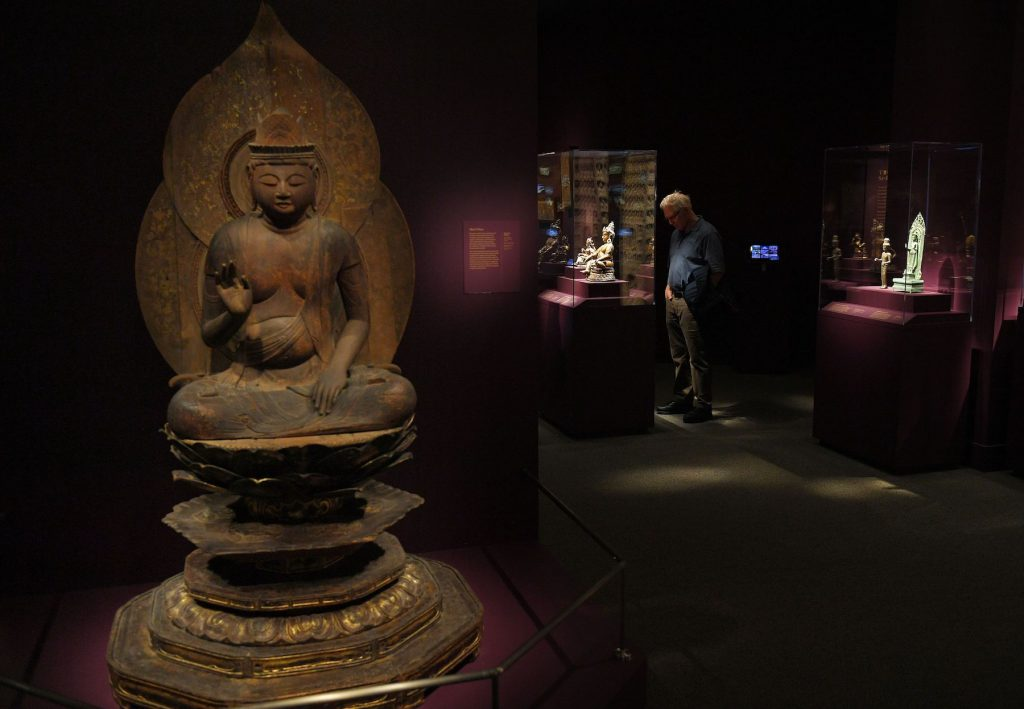 Visitors to the Arthur M. Sackler Gallery look at an exhibition on Buddhas in Washington, DC on March 26, 2019. - (Photo by Mandel Ngan/AFP via Getty Images)