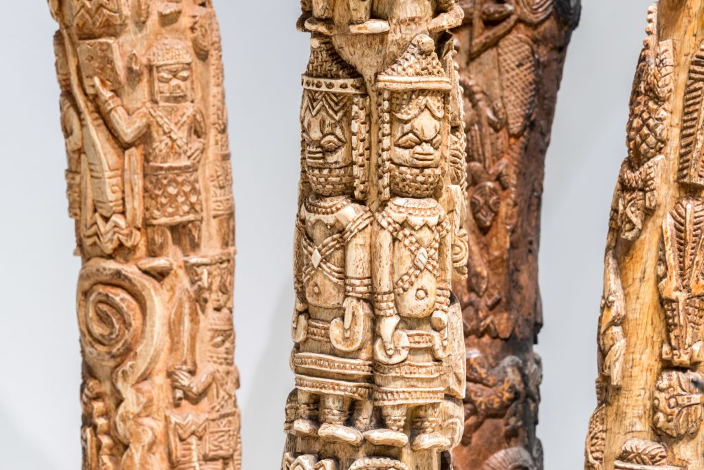 """Carved elephant tusks looted by British soldiers from the Kingdom of Benin in 1897 are displayed in the """"Where Is Africa"""" exhibition at the Linden Museum on May 05, 2021 in Stuttgart, Germany. Photo: Thomas Niedermueller/Getty Images."""