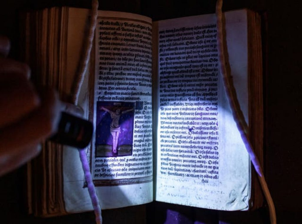The hidden words and names in Anne Boleyn's Book of Hours prayer book revealed by ultra-violet light. Photo courtesy of Hever Castle & Garden.
