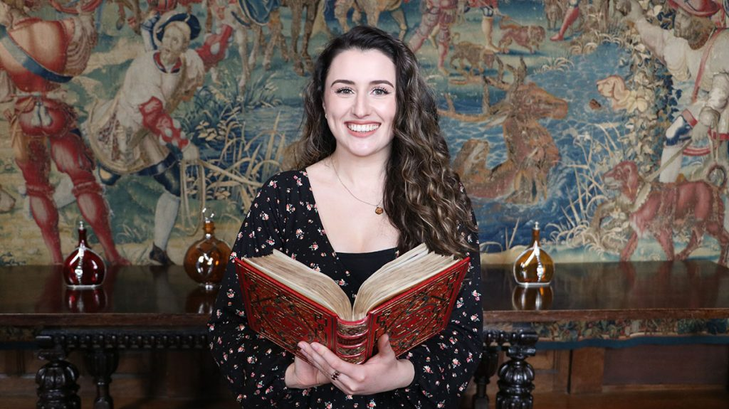 Kate McCaffrey with Anne Boleyn's Book of Hours prayer book. Photo courtesy of Hever Castle & Garden.
