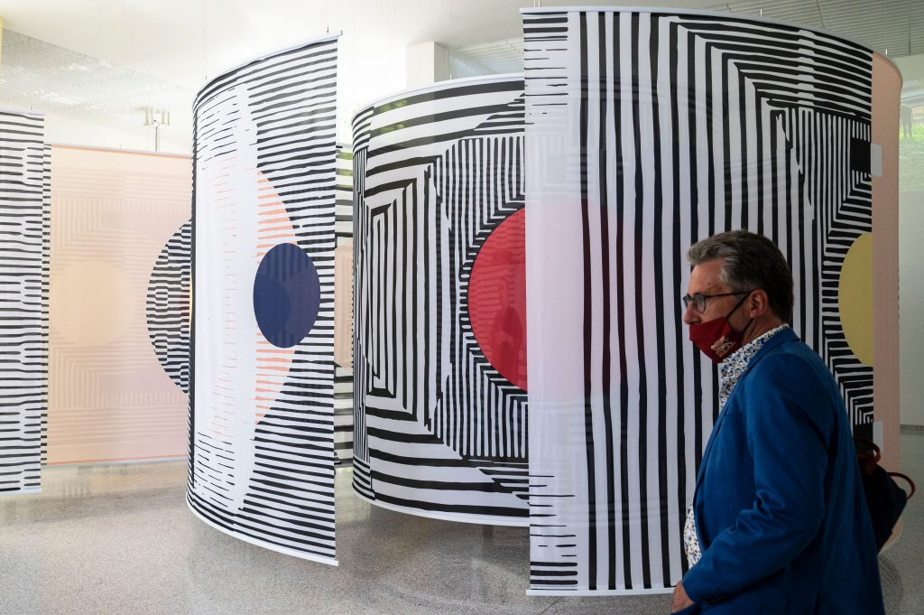 """A visitor views """"Why is We"""" by Afaina de Jong and Debra Solomon at the Dutch pavilion of the 17th Venice Architecture Biennale in Venice on May 19, 2021. Photo by Marco Bertorello/AFP via Getty Images."""