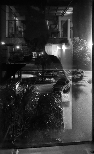 John Sims, <i>A Near Death Residency: Reflections of a Black Artist/Space</i> (2021). Sims took this photo as the police were leaving the premises. © John Sims