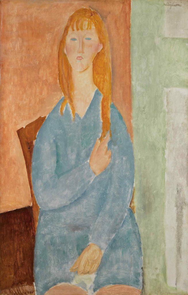Amedeo Modigliani, <i>Jeune fille assise, les cheveux dénoués (Jeune fille en bleu)</i> (1919). Image courtesy Sotheby's.