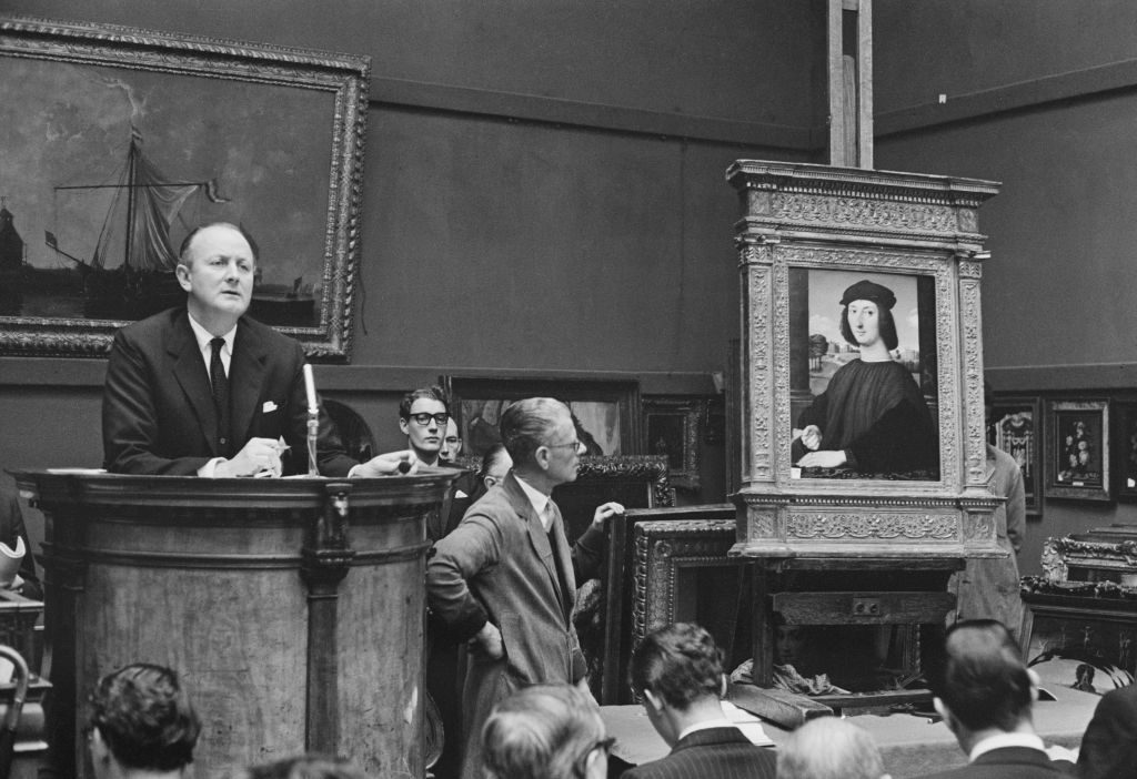 Sotheby's Chairman and chief auctioneer Peter Wilson (1913-1984) conducts a sale of Renaissance paintings at Sotheby's auction house in London on 28th November 1963. Photo by Les Lee/Daily Express/Hulton Archive/Getty Images.