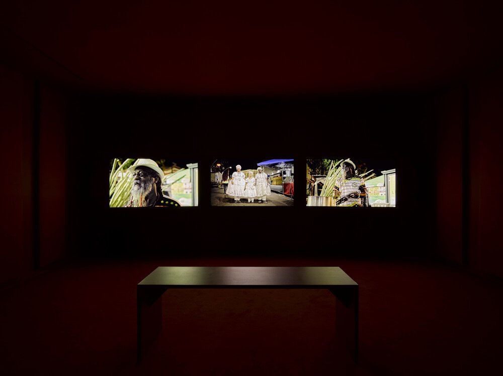 """Installation view of """"John Akomfrah: The Unintended Beauty of Disaster Triptych"""" (2020). Courtesy of Lisson Gallery."""