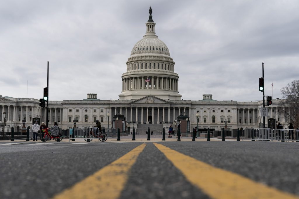 Clouds pass overt the Capitol Dome as the Senate resumes debate on the National Defense Authorization Act (NDAA) on December 31, 2020 in Washington, DC. (Photo by Joshua Roberts/Getty Images)