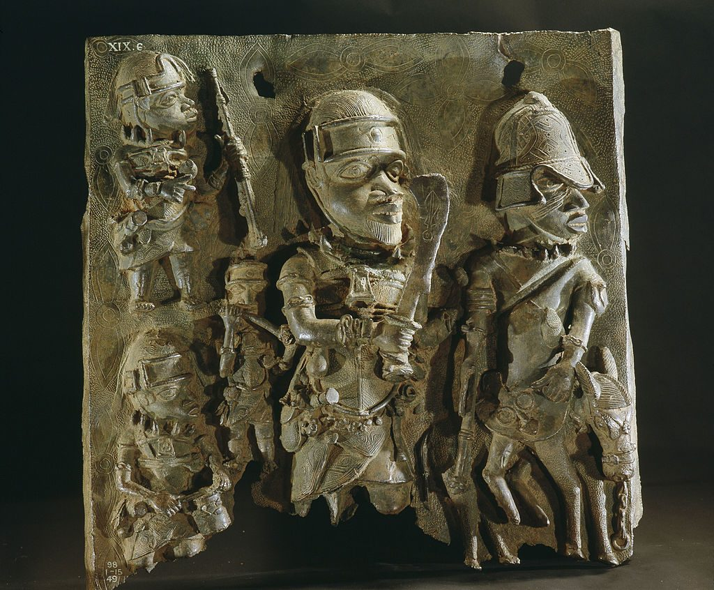 A plaque which decorated the palace of the Obas, Benin warriors are depicted in battle. Nigeria. Edo. Probably late 17th century. Benin City. (Photo by Werner Forman/Universal Images Group/Getty Images)