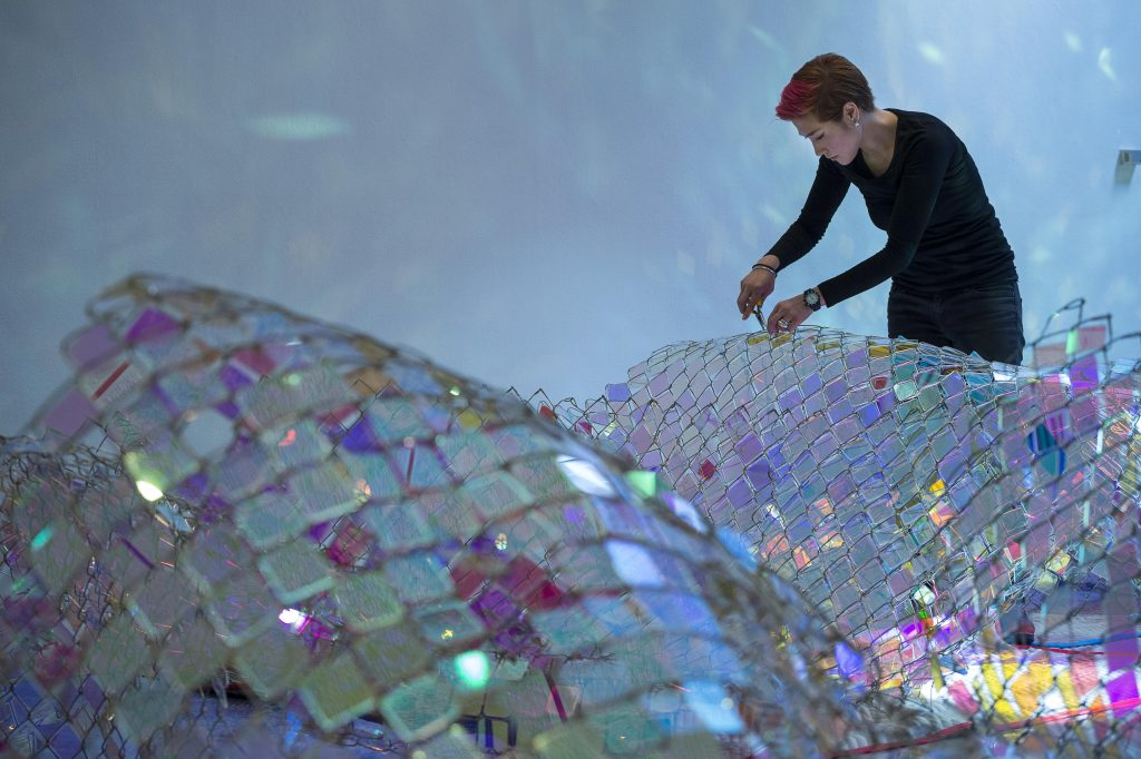 Soo Sunny Park installing work at the Rice Gallery. Photo by Nash Baker courtesy of the artist.