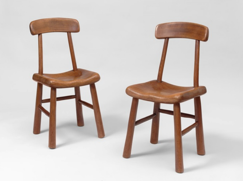 Alexandre Noll, Pair of chairs in carved mahogany (1940). Courtesy of Galerie Jacques Lacoste.