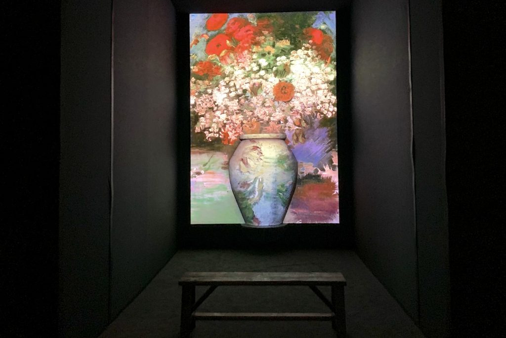 """A giant sculptural vase with Van Gogh images projected on it at """"Van Gogh: The Immersive Experience."""" Photo by Ben Davis."""