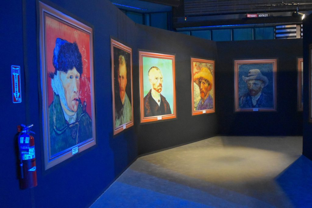 "Display of replica Van Gogh self-portraits at ""Van Gogh: The Immersive Experience."" Photo by Ben Davis."