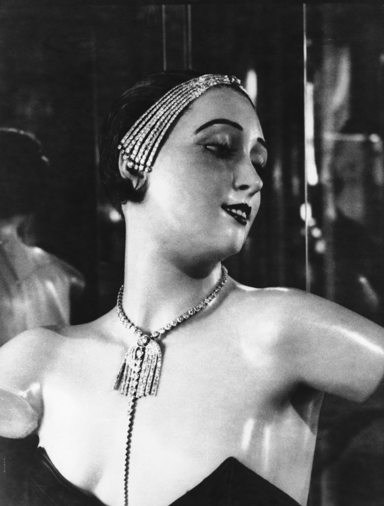 A wax mannequin wearing a necklace and jewelled headband designed by French fashion designer Coco Chanel, Paris, circa 1932. (Photo by Albert Harlingue/Roger Viollet via Getty Images)