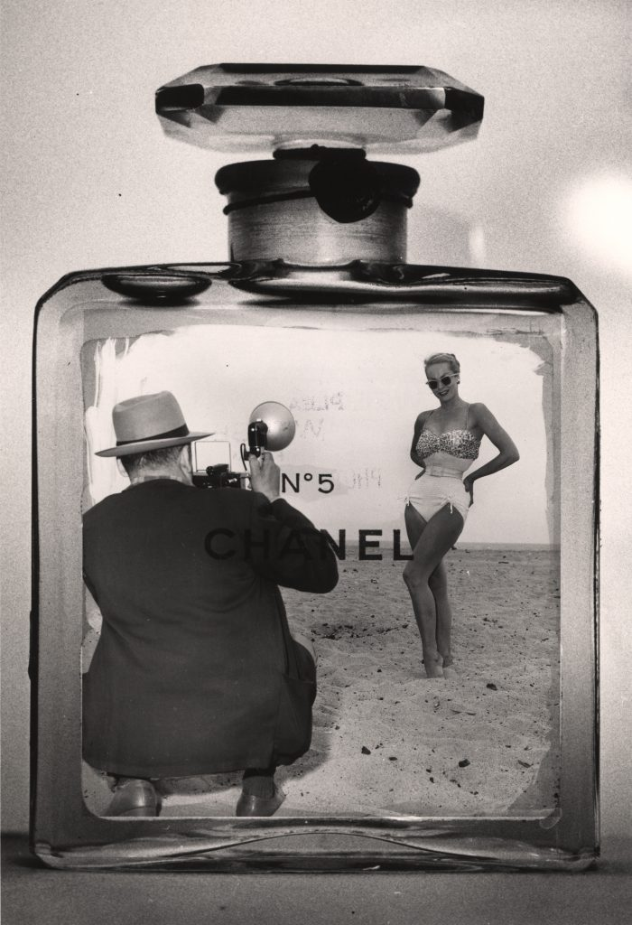Photomontage of American photographer Weegee (1899 - 1968) taking a photograph of a woman in a bathing suit inside a Chanel No. 5 bottle in the late 1950s. (Photo by Weegee(Arthur Fellig)/International Center of Photography/Getty Images)