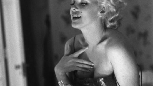 """Actress Marilyn Monroe gets ready to go see the play """"Cat On A Hot Tin Roof"""" by applying her make up and Chanel No. 5 perfume on March 24, 1955 at the Ambassador Hotel in New York City, New York. (Photo by Ed Feingersh/Michael Ochs Archives/Getty Images)"""
