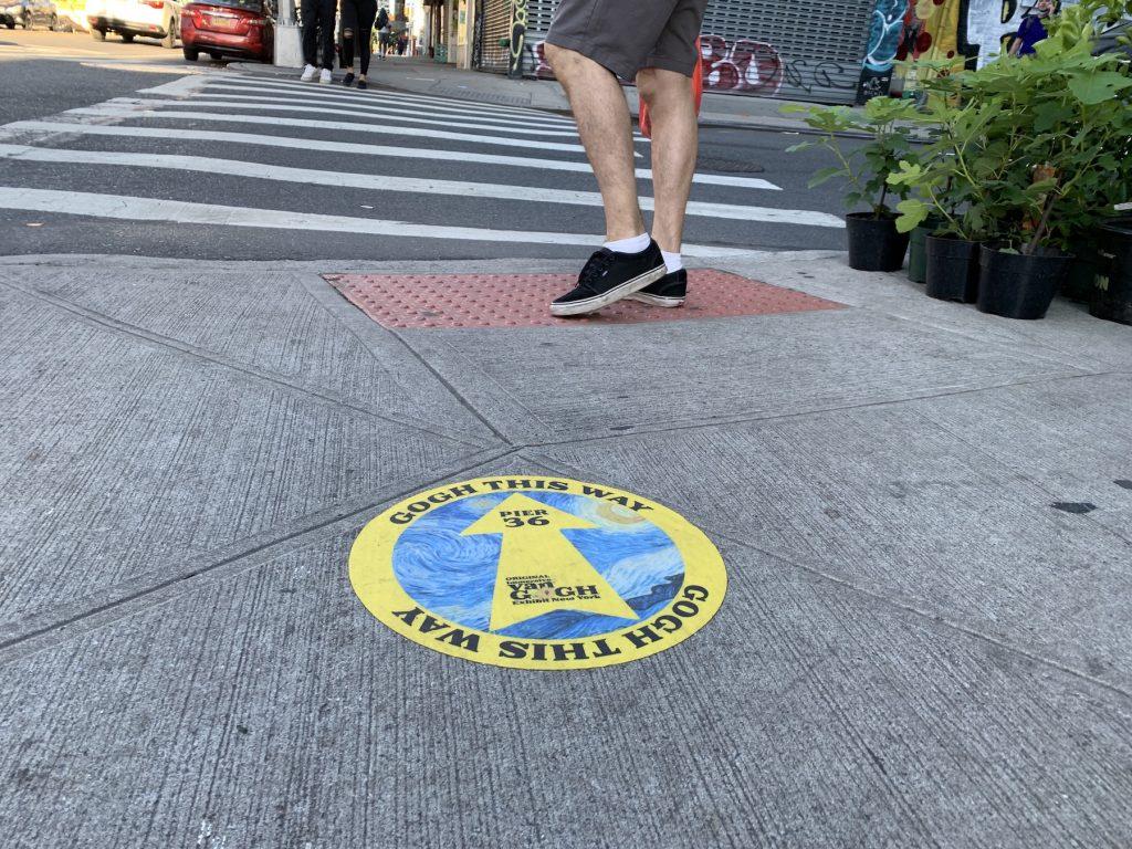 "Marker directing people to ""Immersive Van Gogh"" in Chinatown. Photo by Ben Davis."
